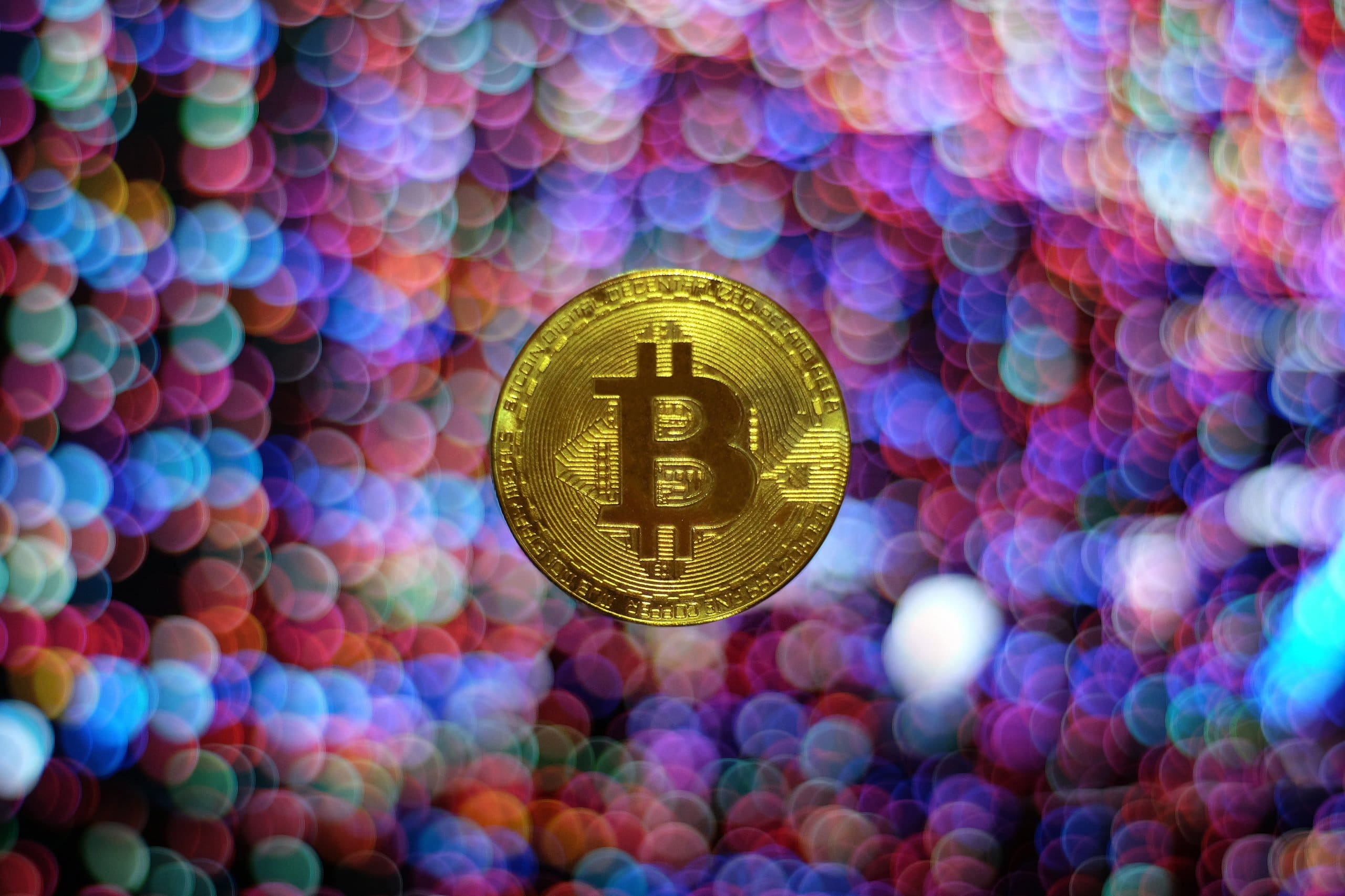 round gold-colored Bitcoin illustration